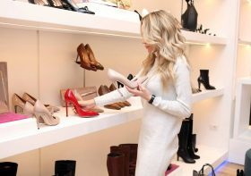 Woman Shopping for Shoes at Retailer