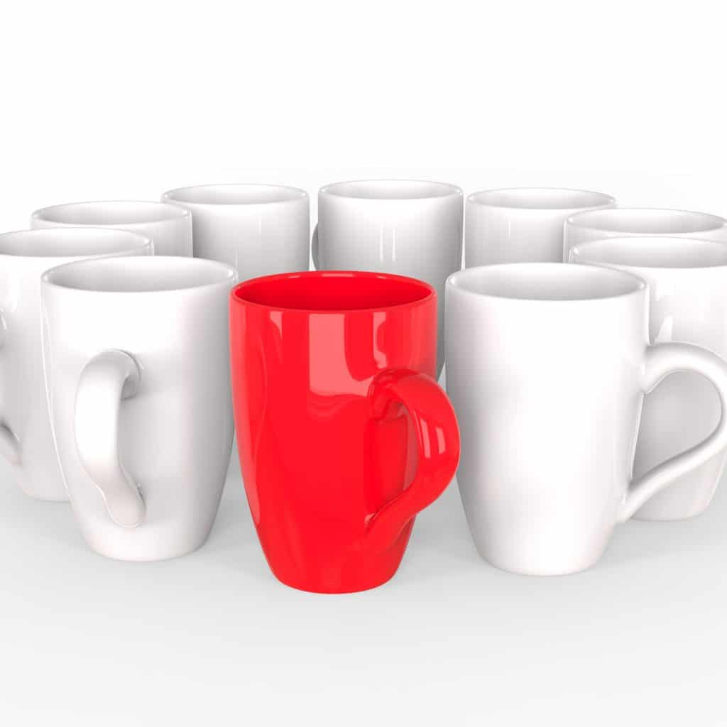 Red coffee mug stands out of circle